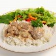 Stock Photo: Beef stroganoff with salad
