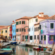 The already fantastic colours of houses in Burano - Stock Photo