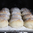 Bread rolls in the oven - Stock Photo