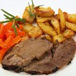 Stock Photo: Plate of roast lamb