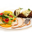 Stock Photo: Sliced turkey and salad meal side view