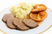Roast beef and Yorkshire puddings — Stock Photo