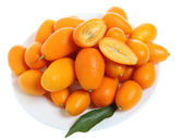 Kumquats on a plate — Stock Photo
