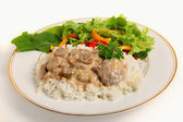 Beef stroganoff with salad — Stock Photo