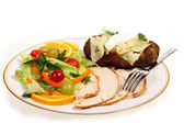 Sliced turkey and salad meal side view — Stock Photo
