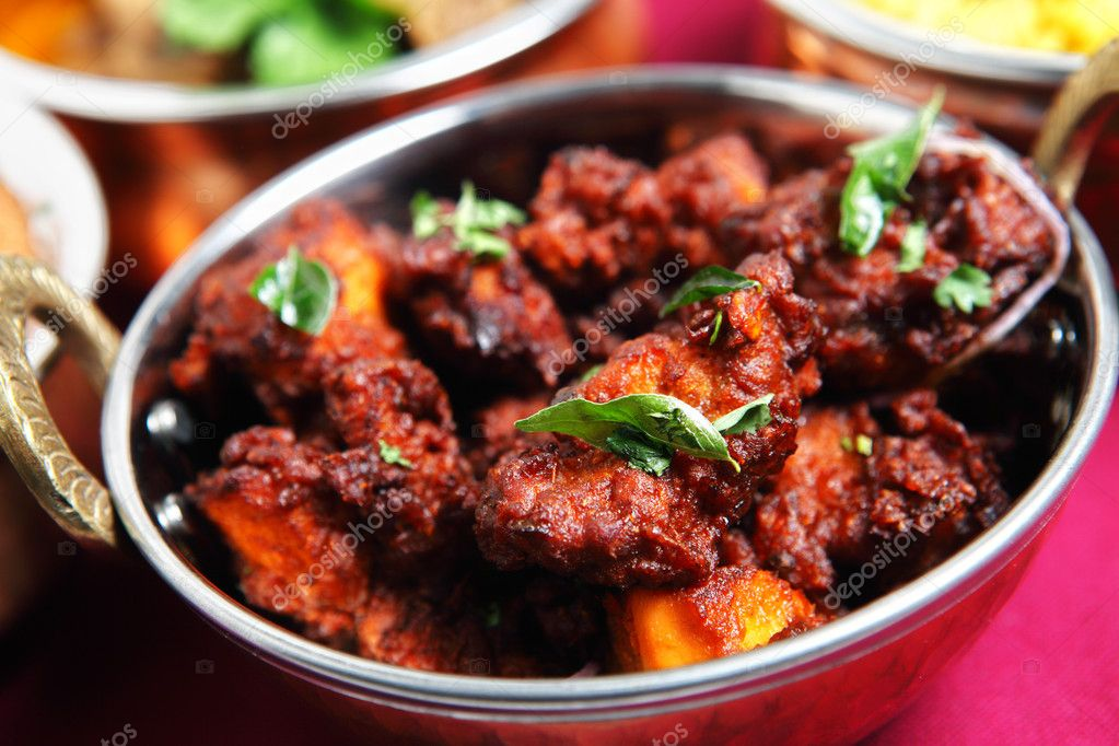 Authentic Kerala chicken fry garnished with curry leaves, a popular ...