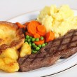 Stock Photo: Steak, veg and Yorkshire pud