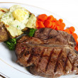 T-bone steak dinner - Stock Photo