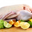 Raw duck with citrus fruits — Stock Photo