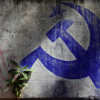 A blue hammer and sickle painted on a wall in Varkala, Kerala, India. - Stock Photo