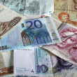 Euro and legacy currencies - Stock Photo