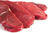 Four rump steaks, close-up — Stock Photo