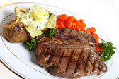 T-bone steak dinner — Stock Photo