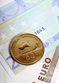 Drachma coin on euro notes — Stock Photo
