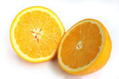 Navel orange cut in half — Stock Photo