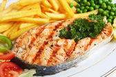 Grilled salmon steak with veg — Stock Photo