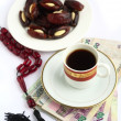 Coffee dates worry beads arab money — Stock Photo