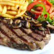 Stock Photo: Grilled ribeye steak dinner