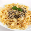 Stock Photo: Mushrooms in cream on fettuccini