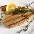 Grilled tuna and lemon wedge - Stock Photo