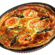 Whole quiche in baking pan — Stock Photo