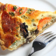 Stock Photo: Slice of quiche from above