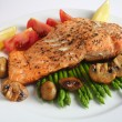 Salmon steak dinner with mushroom, asparagus, tomatoes — Stock Photo