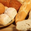 Bread board and breadbasket - Stock Photo