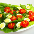 Gourmet quails egg and tomato salad — Stock Photo