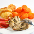 Stock Photo: Herbed baked chicken breast meal