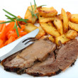Foto Stock: Roast lamb and veg mediterranean style
