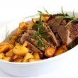 Lamb joint and roast potatoes — Stock Photo