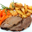 Stock Photo: Roast lamb with potatoes and carrots