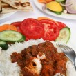 Chicken tikka masala meal vertical - Stock Photo