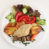 Chicken and mushroom casserole with salad — Stock Photo