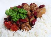 Close-up on chilli stew in a bed of rice — Stock Photo