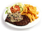 Steak and mushroom sauce — Stock Photo