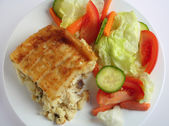 Fish pie and salad from above — Stock Photo