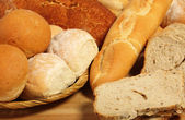 Bread board and breadbasket — Stock Photo