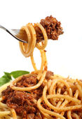 Spaghetti bolognese on a fork — Stock Photo