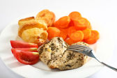 Herbed baked chicken breast meal — Stock Photo