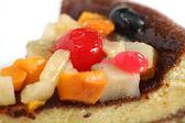 Fruit topped sponge cake macro — Stock Photo