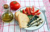 Sardines with tomato and bread — Stock Photo