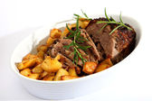 Lamb joint and roast potatoes — Stock Photo