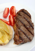 Grilled New York steak vertical — Stock Photo