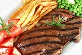 Grilled steak dinner — Stock Photo