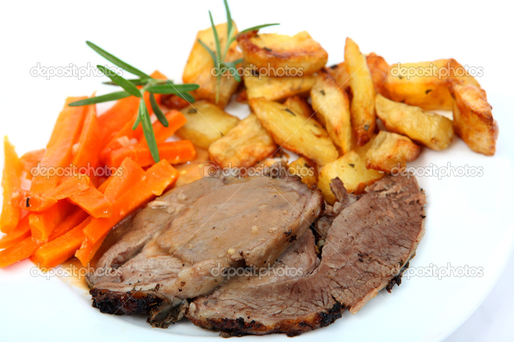 Slices of herbed roast lamb with gravy, served with steamed garlic and carrots and diced roast potatoes, and sprigs of rosemary — Stock Photo #7055870