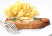 Grilled kipper and mashed potato and fork — Stock Photo
