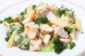 Grilled chicken broccoli and pasta in sauce — Stock Photo