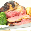 Roast sirloin beef joint with knife — Stockfoto